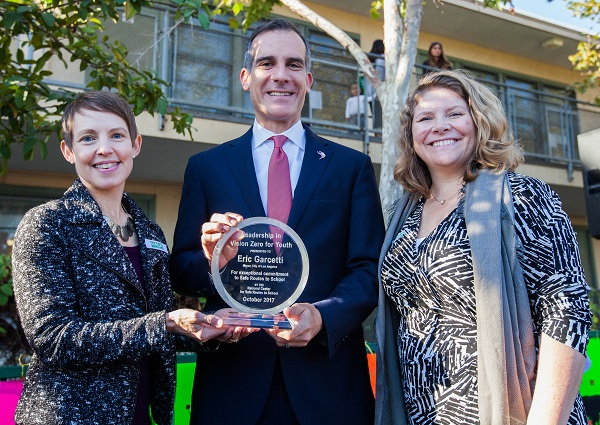 Nancy Pullen-Seufert (left) Director, National Center for Safe Routes to School, presents award to Mayor Eric Garcetti and Seleta Reynolds (right), General Manager, LA Department of Transportation. An award will also be presented to Dr. Michelle King, Superintendent, LA Unified School District.