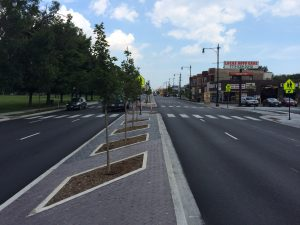 Final results of the work on North Western Avenue including high visibility crosswalks and extended raised medians with pedestrian refuge space.
